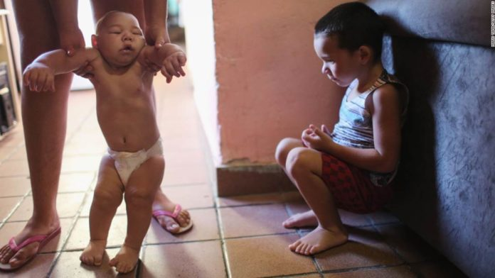 The World Health Organization announced that the Zika virus outbreak, linked to deformations in babies' heads and brains, no longer poses a world public health emergency, but stressed the need for sustained effort to address the disease, which has been linked to congenital and other neurological disorders.