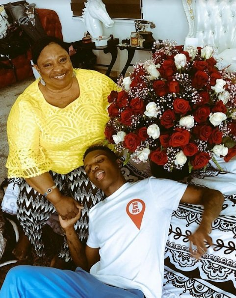 image of wizkid and hist mother - wizkid networth