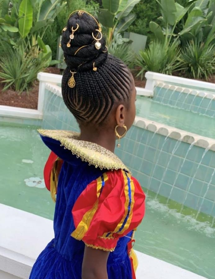 woman with Braided shuku - the latest hairstyles in Nigeria