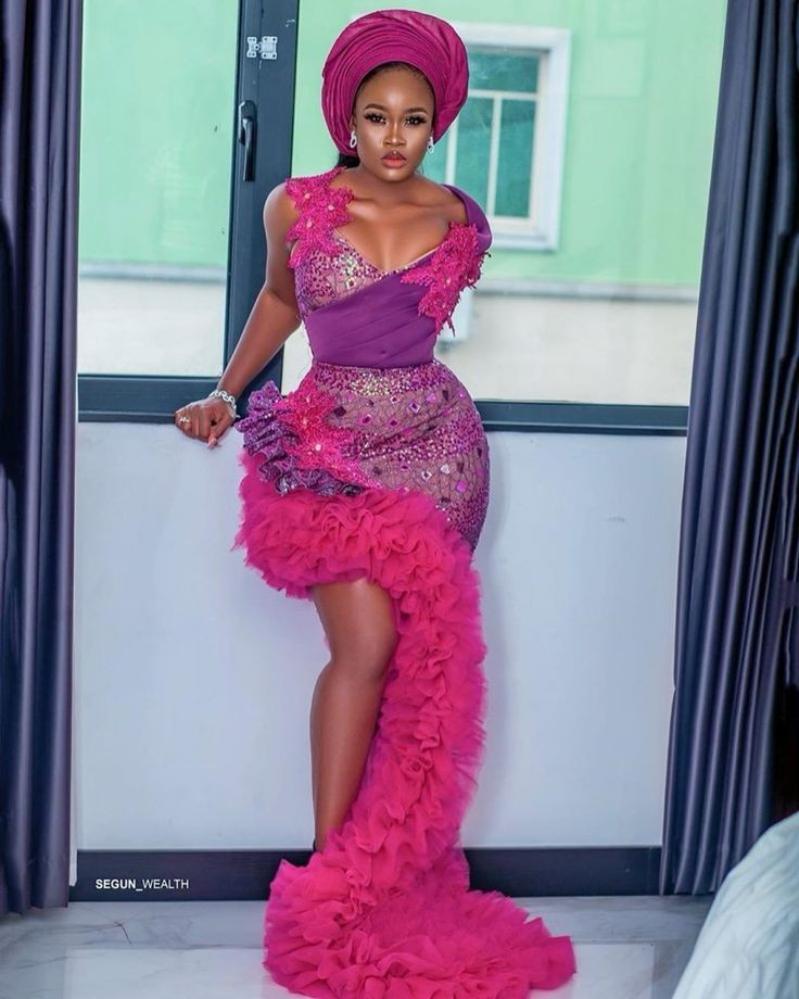 Wine color lace outfit in Nigeria